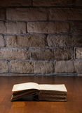 Book on wooden table Stock Photo