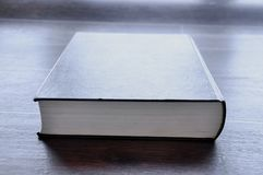 Book on wooden table royalty free stock image
