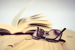 Book on wooden table Royalty Free Stock Images