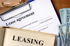 Book with word leasing,  lease agreement form. Stock Photo