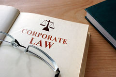 Book with words corporate law. Book with words corporate law and glasses Stock Images