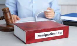 Book with words IMMIGRATION LAW, gavel royalty free stock photography