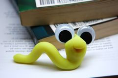 Book Worm. Worm made from modeling clay smiling on books Stock Images