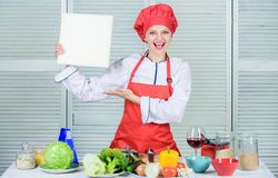 Book written by me. Book by famous chef. Improve cooking skill. Book recipes. According to recipe. Woman chef cooking. Food. Culinary concept. Amateur cook read stock photo