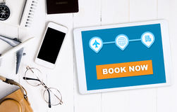 Book your vacation travel now on tablet Stock Photography