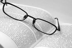 Book2. History book with glasses in black and white Stock Image