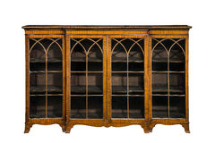 Bookcase cabinet antique vintage with glass doors isolated Stock Images
