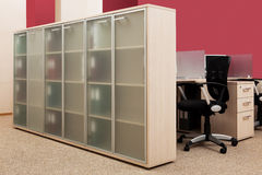Bookcase with folders royalty free stock photography