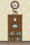 Bookcase. With knick knacks and books under a clock in a living room Royalty Free Stock Photo