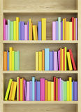 Bookcase with multicolored books Stock Photos