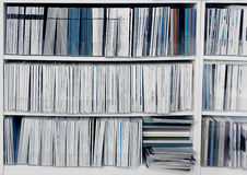 Bookcase with publications Royalty Free Stock Image