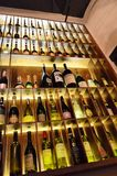 Bookcase with wine bottles Stock Photography