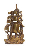 Bookend. Brass bookend in the shape of an ancient sailing ship Royalty Free Stock Photos