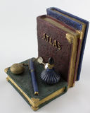 Bookend of Serious Study With Pen Ink Bottle and Glasses. With an Atlas for Reference stock image
