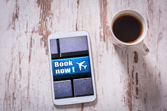 Booking flight on tablet and black coffee Stock Photos