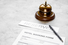 Booking form for hotel room reservation, pen and ring stone background Stock Photography