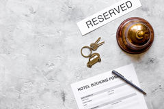 Booking form for hotel room reservation stone background top view space for text Royalty Free Stock Photo