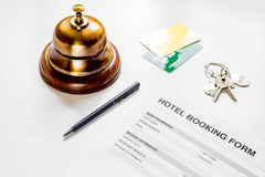 Booking hotel room application form and keys white desk background Royalty Free Stock Photos