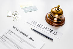 Booking hotel room application form and keys white desk background Royalty Free Stock Image