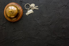 Booking hotel room, ring and keys dark desk background top view mock up Stock Photos