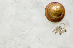 Booking hotel room, ring and keys stone desk background top view mock up Stock Photo