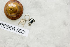 Booking hotel room, ring and keys stone desk background top view mock up Stock Photography