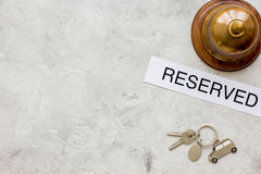 Booking hotel room, ring and keys stone desk background top view mock up Royalty Free Stock Photos