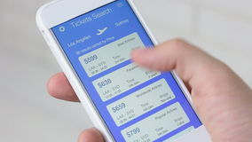 Booking plane ticket using smartphone application stock video footage