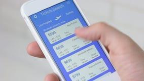 Booking plane ticket using smartphone application. Using smartphone application stock video footage