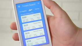 Booking plane ticket using smartphone application stock footage