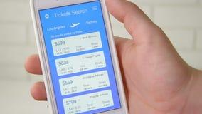 Booking plane ticket using smartphone application. Using smartphone application stock footage