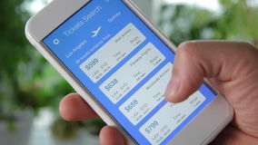 Booking plane ticket using smartphone application stock video