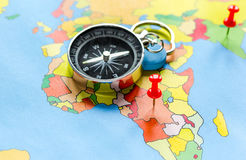 Booking travel concept with compass on map background Stock Photo