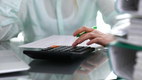 Bookkeeper or financial inspector making report, calculating or checking balance. Audit and tax service concept. Gree. N colored image background stock photography