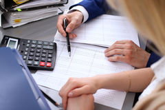 Bookkeeper or financial inspector and secretary making report, calculating or checking balance. Internal Revenue Service. Inspector checking financial document royalty free stock photography