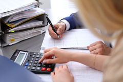 Bookkeeper or financial inspector and secretary making report, calculating or checking balance. Internal Revenue Service Royalty Free Stock Photography