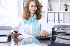 Free Bookkeeper Or Financial Inspector Making Report, Calculating Or Checking Balance. Stock Photos - 137411343