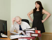 Bookkeeper and the secretary on a workplace. The bookkeeper and the secretary on a workplace at office royalty free stock photos