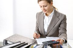 Bookkeeper woman or financial inspector making report, calculating or checking balance. Business portrait. Copy spac. E area for audit or tax concepts royalty free stock images