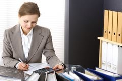 Bookkeeper woman or financial inspector making report, calculating or checking balance. Business portrait. Copy spac. E area for audit or tax concepts royalty free stock photo