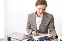 Bookkeeper woman or financial inspector making report, calculating or checking balance. Business portrait. Copy spac. E area for audit or tax concepts stock images