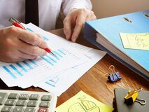 Free Bookkeeper Working Financial And Budget Report. Accounting Concept Stock Images - 172873344