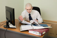 Bookkeeper on a workplace at office Royalty Free Stock Image