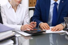 Bookkeepers team or financial inspectors  making report, calculating or checking balance. Tax service financial documen. T. Audit concept Royalty Free Stock Image