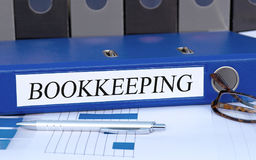 Free Bookkeeping - Blue Binder With Text In The Office Stock Image - 96149461