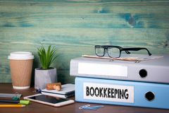 Bookkeeping concept. Binders on desk in the office. Business background royalty free stock photo