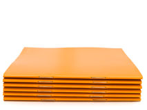 Booklets. Photo of the some orange booklets against the white background Royalty Free Stock Photography