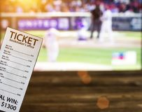 Bookmaker ticket on the background of a TV showing baseball, sports betting, bookmaker