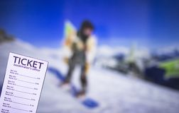 Bookmaker ticket on the background of a TV showing snowboarding, sports betting, bookmaker ticket. Bookmaker ticket on the background of a TV showing royalty free stock photos