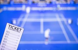 Bookmaker ticket on the background of the TV on which the game is shown tennis, sports betting, bookmaker, tennis. Bookmaker ticket on the background of the TV stock photos